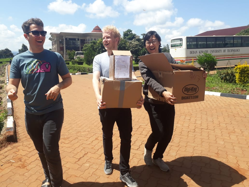 Damon Civin, Jan Jongboom and Gen-Tao Chiang with a lot of boxes